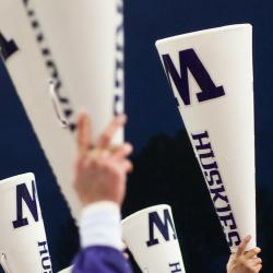 People holding white UW branded analog megaphones in the air